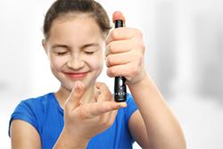 girl closing her eyes to take a diabetes test