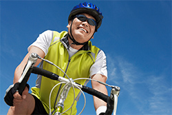upshot of a cyclist wearing sunglasses for protection from sun