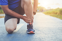 Runner holding onto their ankle