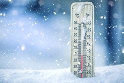 Thermometer in snow showing low temperatures
