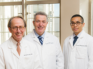 Dr. M. Cary Reid, Dr. Ronald D. Adelman, and Dr. Veerawat Phongtankuel