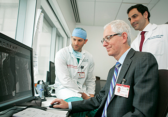 Dr. Eric H. Elowitz (center) with Dr. Jared Knopman and Dr. Michael S. Virk