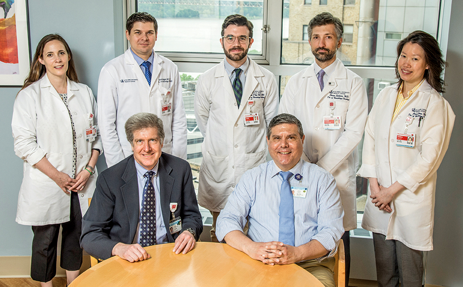 Image of Dr. Mark L. Heaney and Anthony Rainone with 2018 Young Investigator Award recipients