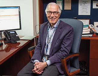 Dr. J. John Mann