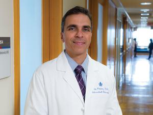 Dr. John M. Poneros