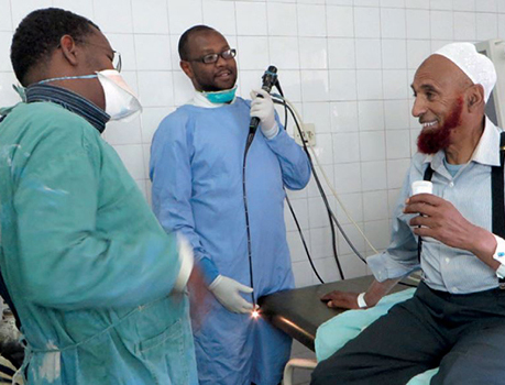 Doctors with patient at East African Training Initiative.