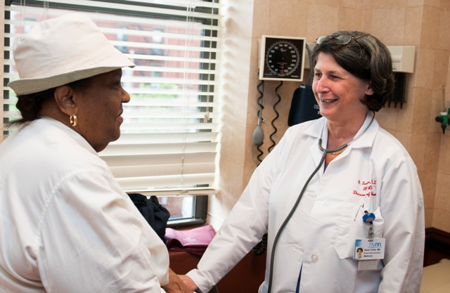 Gioia Turitto, MD, with a patient,