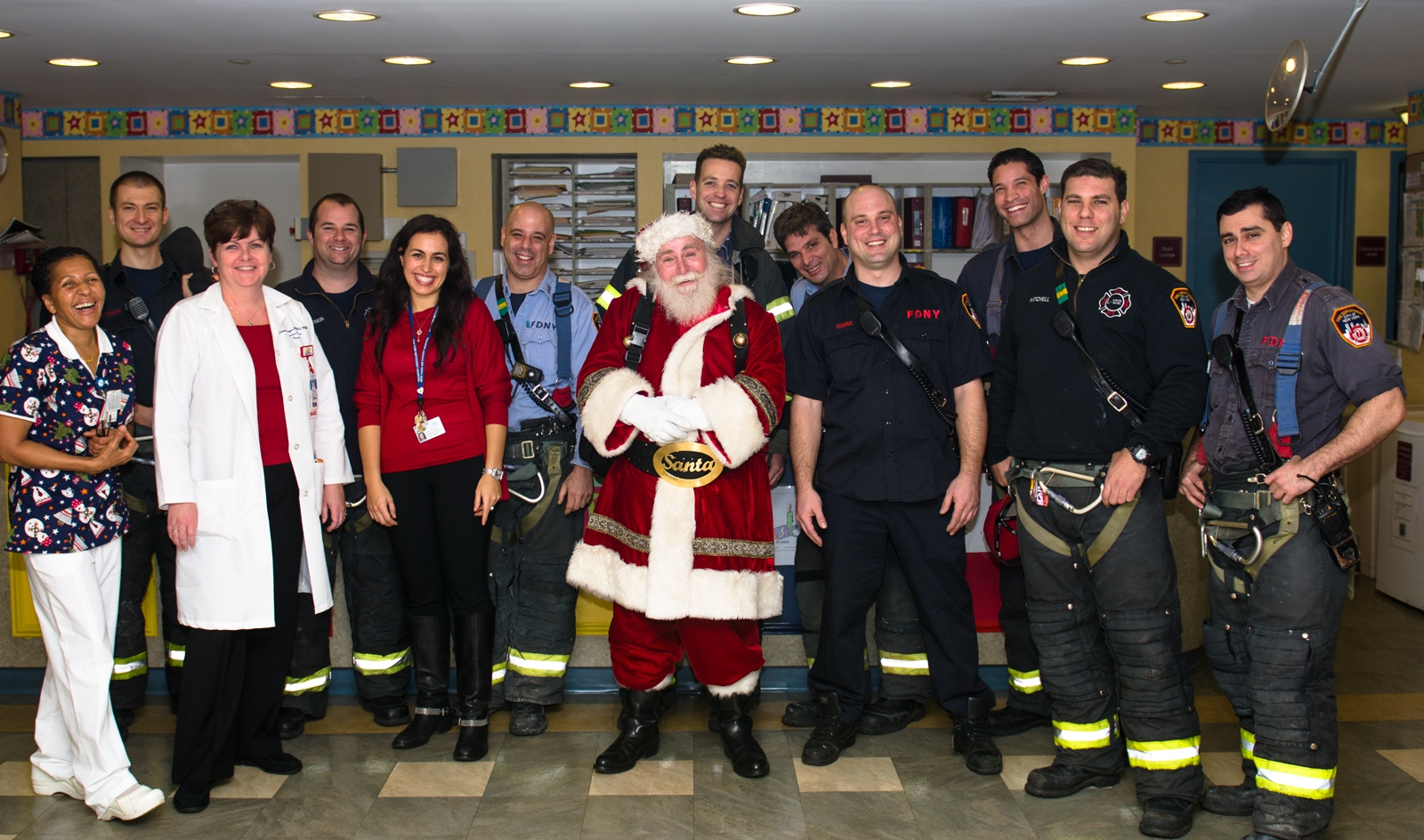 NYM staff, Santa, and Firefighters