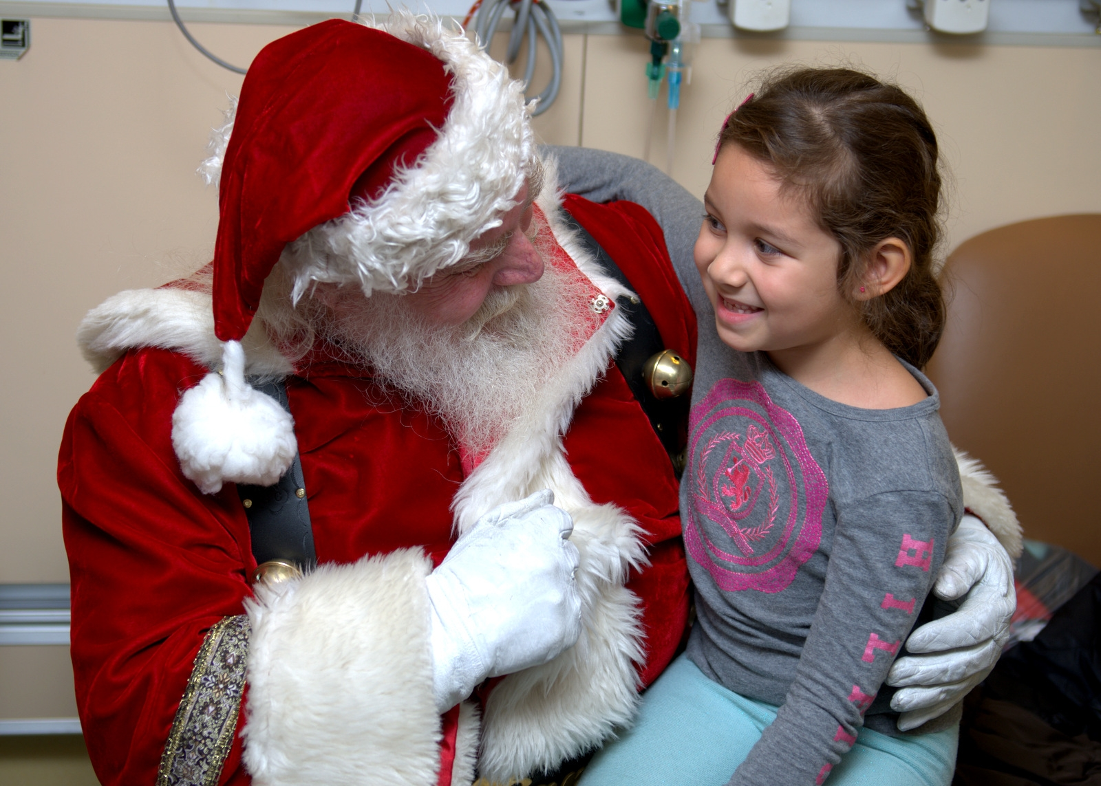 Santa with patient in NYM Pediatric Emergency Room