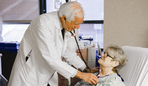Doctor examining elderly patient