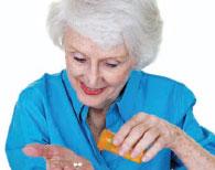 Picture of elderly person taking prescription