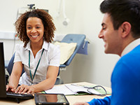 patient and administrator talk in exam room