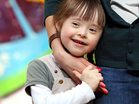 young girl with special needs smiles