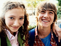 teenage boy and girl smile