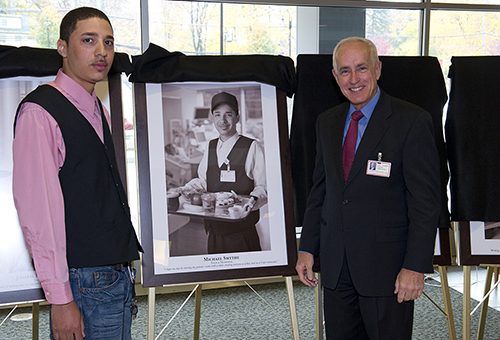 John Federspiel, President, congratulates Michael Smythe as his portrait is unveiled.