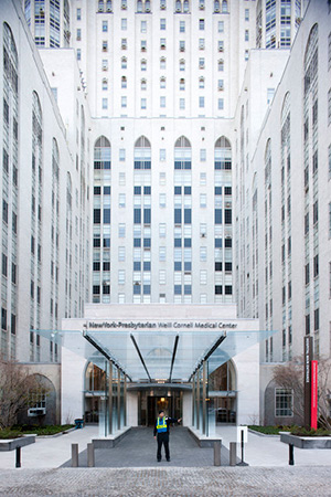front view image of NYP Weill Cornell Medical Center with a person standing infront