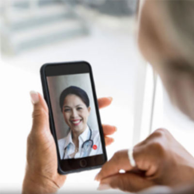 patient looking at doctor on phone