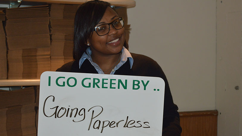 NYP employee goes green by going paperless.