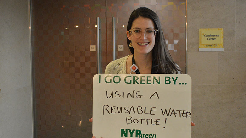 NYP employee goes green by using a reusable water bottle.