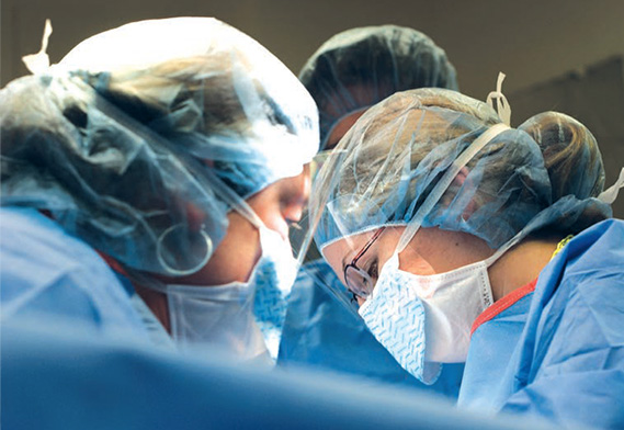 surgeons masked, performing a surgery