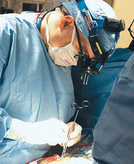 image of a surgeon performing a surgery