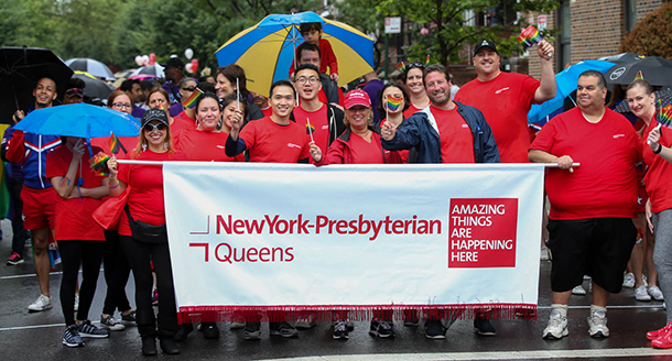 NewYork-Presbyterian Queens employees at the 2016 Queens Pride parade in the rain