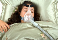 woman with sleep apnea sleeps in bed with