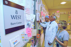 Dr. Roger Yurt and others view cards at the Burn Center