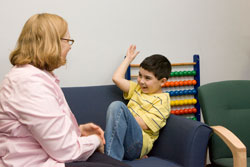 Dr. Lord works with a young boy at the Center for Autism and the Developing Brain