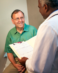 Doctor and an older male patient talk