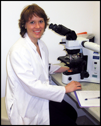 Dr. Hillary D. Johnson at microscope