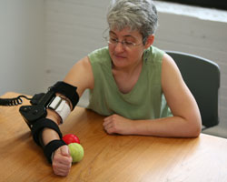 Female patient with e100 robotic device on her arm
