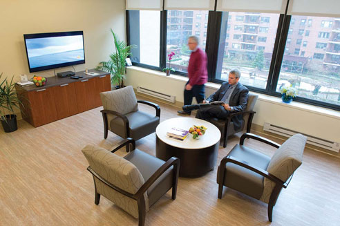 a patient in the waiting area at the Executive Health program at New York Presbyterian