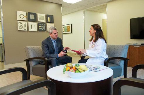 a patient talks with Wanda See, DNP, ANP-BC, at the Executive Health program at New York Presbyterian