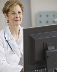 Female doctor at computer