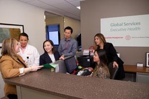 Global Services staff around reception desk