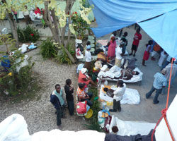 Patients outside a hospital after the earthquake in Haiti