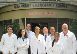 Students from the Lang Youth Medical Program pose at the entrance to the emergency department at New York Presbyterian Weill Cornell