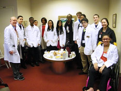 Students from the Lang Youth Medical Program at a small office party