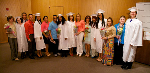 Students from the Lang Youth Medical Program in graduation gowns with their parents