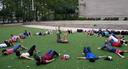 Students from the Lang Youth Medical Program exercise on a lawn