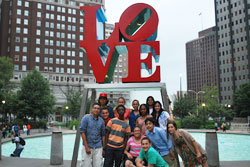 Students from the Lang Youth Medical Program pose near a statue in New York City