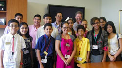 Students from the Lang Youth Medical Program pose with Dr. Robert Kelly, President of New York Presbyterian