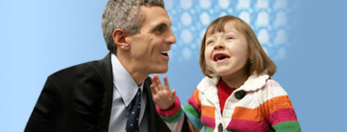 Neurosurgeon Mark Souweidane, M.D., with young patient