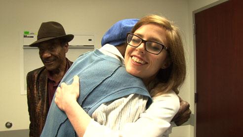 Dr Ashley Winter hugs patient Levorne Moore
