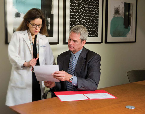 Orli Etingin, M.D., consults with a patient in the Executive Health program at New York Presbyterian