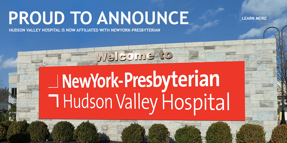 exterior of stone wall at Hudson Valley Hospital with sign announcing its new affiliation with New York Presbyterian