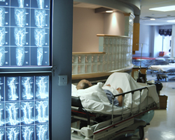 Scans and patient in hospital bed