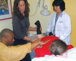 Staff treating child with spasticity disorder