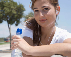 Teenage girl holds a bottle of water